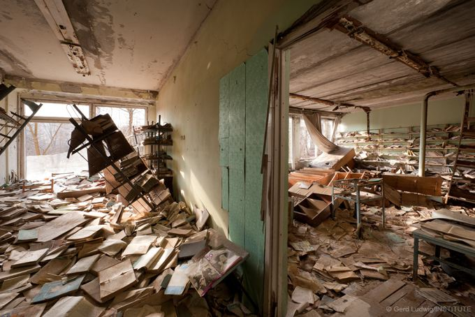 Books rot in a former school library in the ghost town of Pripyat