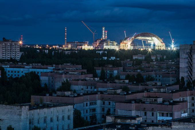 First section of the New Safe Confinement seen from the rooftops of nearby city of Pripyat